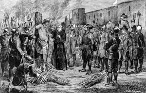 The execution of the Inca/A.B. Greene. Spaniards burn Inca emperor Atahualpa at the stake; to the right is a monk holding a crucifix.