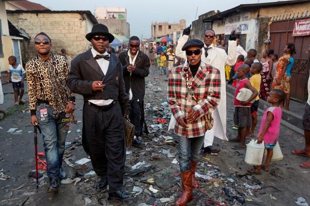 Kinshasa's young fashionistas parade the Matonge neighborhood wearing haute couture.
