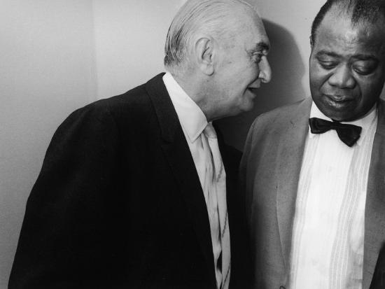 manager-joe-glaser-conferring-with-client-musician-louis-armstrong-after-a-concert_u-l-p76prr0.jpg